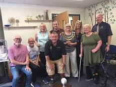 Nick is shown with some of the members and trustees of StrokeInformation, together with support dog Misty the Alsatian