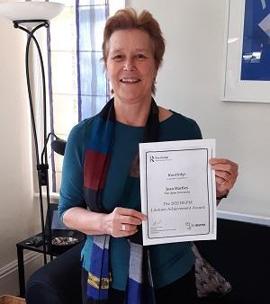 Jean Hartley with award