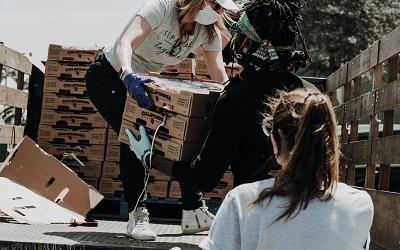 Photo by Joel Muniz on Unsplash - charity workers unloading boxes