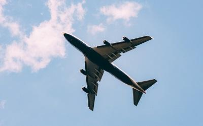 Photo of a plane in the air - Photo by Jordan Sanchez on Unsplash
