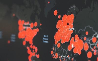Image of global coronavirus cases by Martin Sanchez, Unsplash.