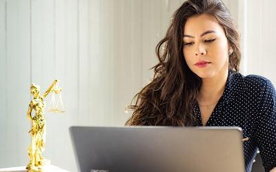 Photo by Mateus Campos Felipe on Unsplash - female lawyer on a laptop