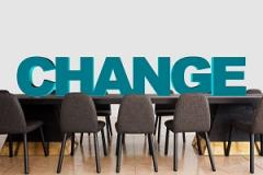 Image containing the word 'Change' on a boardroom table